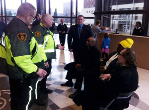UPMC Worker Christoria Hughes, Rev. Rodney Lyde, and Rev. Dr. Ronald Wanless were arrested at UPMC headquarters this afternoon while calling on UPMC to pay all of its employees a living wage.